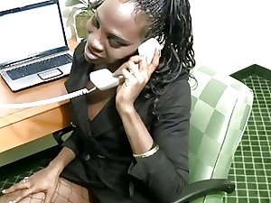 Dark-hued shemale secretary strips off while having a phone fuck-fest