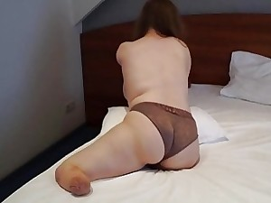 Chubby one-armed brunette amputee puts her lingerie on all alone