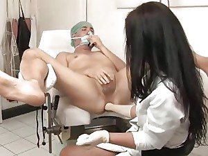Brunette doctor examines patient's guts with her knuckle and toys