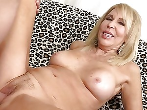 Mature blonde Erica Lauren demonstrates off her vulva and fucks