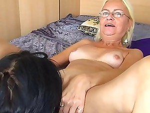Sizzling youthful gal munches and fucks granny